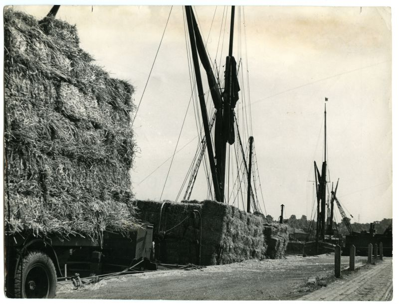 The Hythe, Colchester, Essex. Barges loading straw for Ridham in Kent.