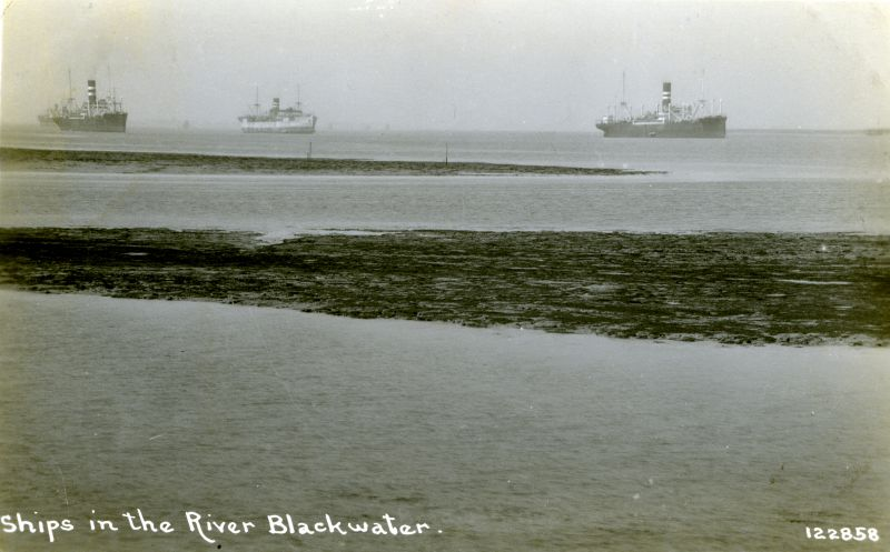 Ships in the River Blackwater Postcard 122858. The ship in the centre is believed to be HIGHLAND WARRIOR. Date: Before 7 December 1932.