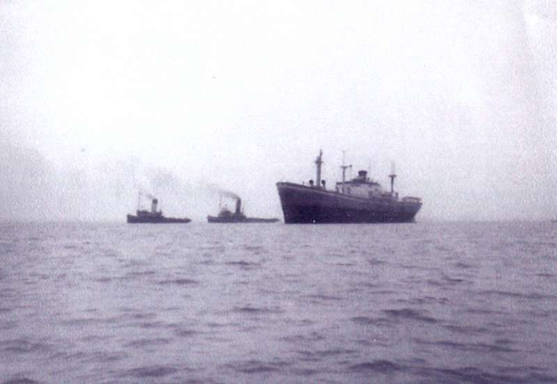 ID AA000720 MICHALAKIS refloated by tugs NAPIA and OCEAN COCK after her time ashore opposite ...