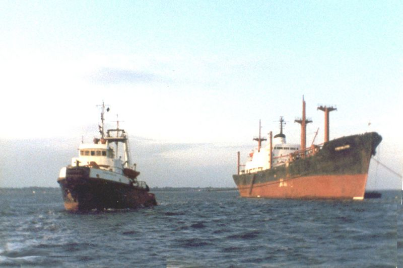 Spanish tug AZNAR JOSE LUIS about to tow PROTOKLITOS to Bilbao for breaking-up. Date: cJune 1983.