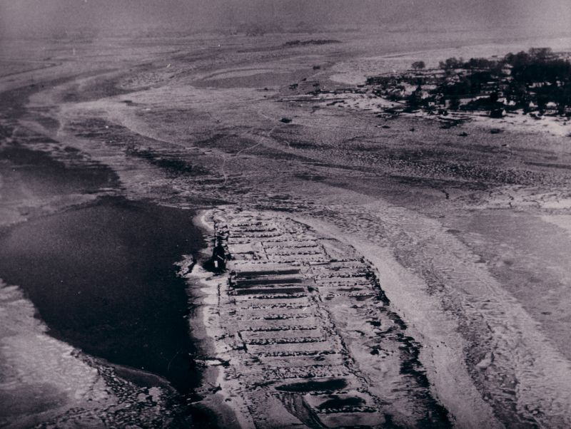 Packing Marsh Island in the severe winter of 1962-63. Viewed from the south with Packing Marsh Island in the centre foreground. There is clear water to the west of Packing Marsh Island but the other creeks are frozen. It was possible to walk across from the causeway to Feldy. 