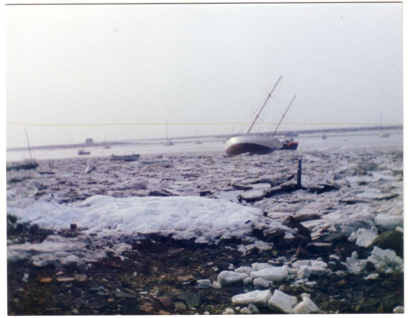 An icy winter - West Mersea with the Packing Shed in the distance. Thought to be late 1980s.