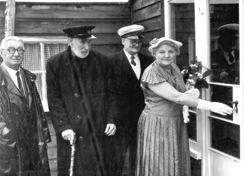Opening of new clubhouse by Winnie Michael-Smith in 1955. L-R 'Bunny' Unwin (sailing sec) Bill Wyatt & Bruce Rainbird (Com) 