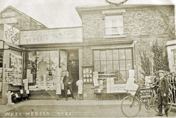 White's shop in Church Road. The bicycle on the right says White's up to date drapers. Postcard franked 18 September 1909. 
