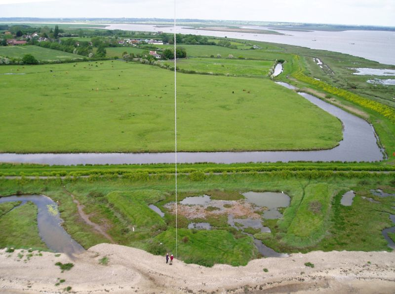 Blockhouse Fort, East Mersea. An aerial view from a kite, looking north. The fort had earth walls and was triangular. The remains are in the lower half of the picture, with two walls pointing to the south. The point is now covered by the beach. The third wall, which would have been across the centre of the picture, is thought to have been destroyed when the sea wall was built.