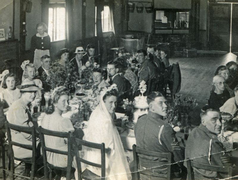 Wedding of Sgt. James Argent and Winifred Joan Mussett. Joan Pullen (Mrs Ward) next to bride. Valerie Farthing (bridesmaid) 2nd from left. British Legion Hall. Catering by Tweed & Son., Colchester.