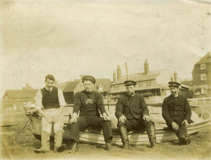 On the Hard, Herbert Welham on the left. Chum Hewes 2nd from right hand side. Old Victory in the background.