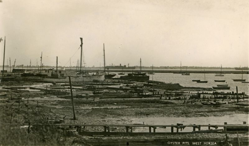 A distant view of the PHILOCTETES laid up in the River Blackwater c1947. She is the left-most of the two vessels in the river. The ketch BLACK FOX can be seen on the edge of the houseboats. Date: Before April 1947.
