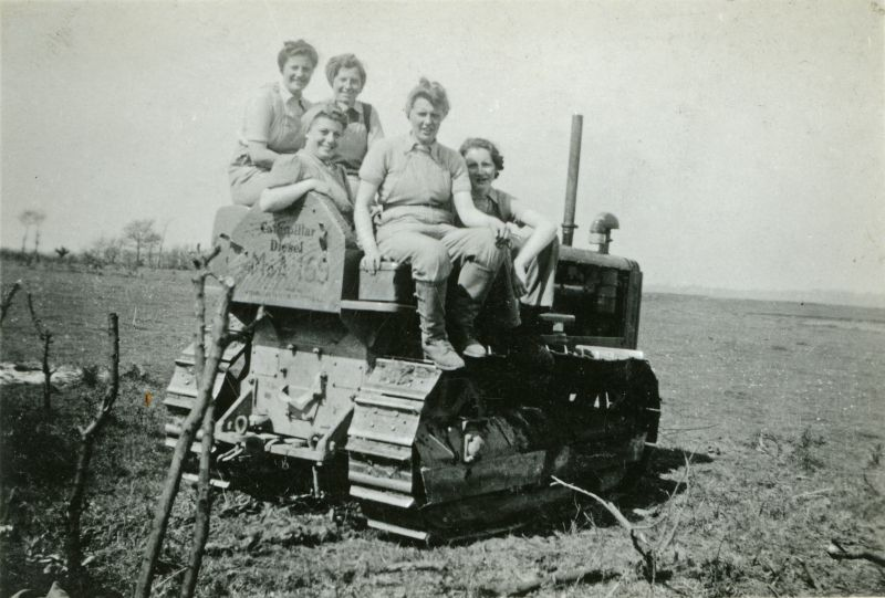 Land Girls at Bower Hall Farm, Mersea. 1. Elsie, 2. Doris, 3. Alexander, 4. Edie, 5. Mona Quick from Shoreditch. Driver Frank Richer. Caterpillar D4 Registration JPU32, Ministry of Agriculture Fleet No MOA159
