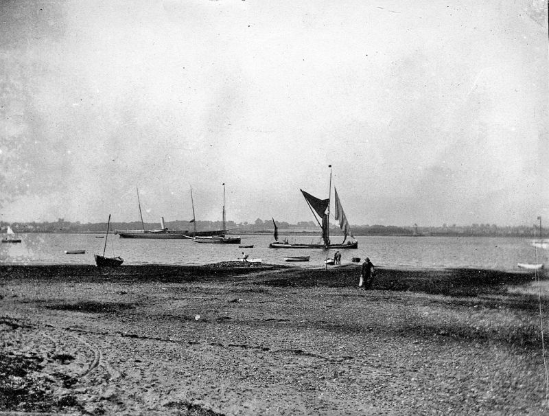 The River Colne from East Mersea. Steam yacht lying in the Pyefleet (VALFREYIA ?) and a barge coming down river. 