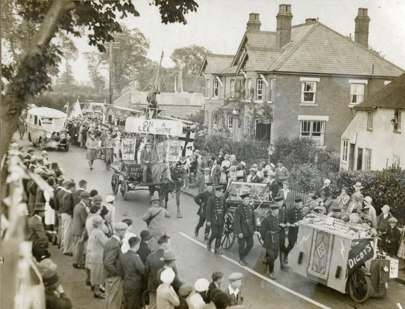 An early 1930s Carnival at Queens Corner passing the Cartwright's Shed, Fountain Hotel (both demolished to build Fountain Court) and Fountain Cottage.