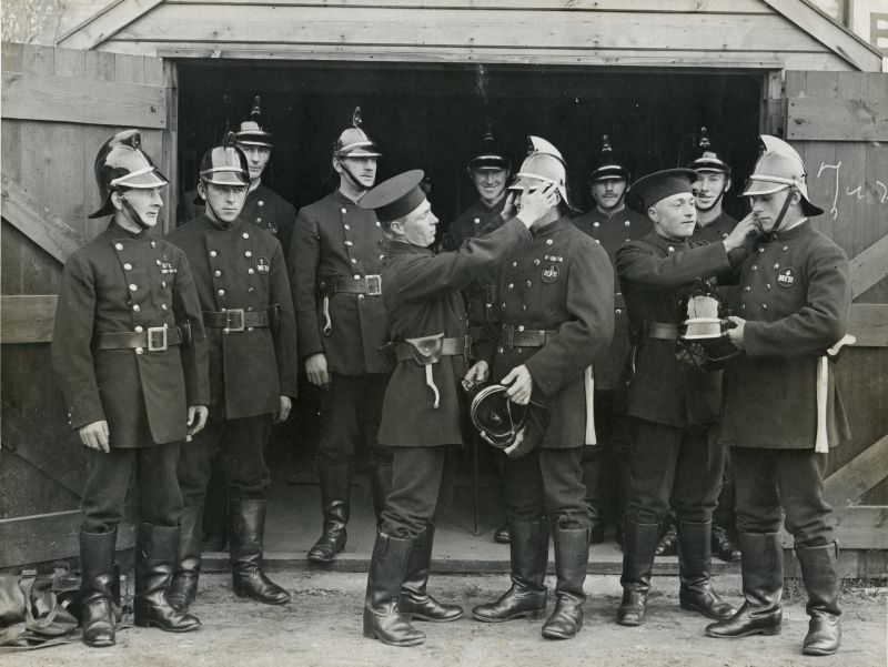 Mersea Firemen trying new helmets. 