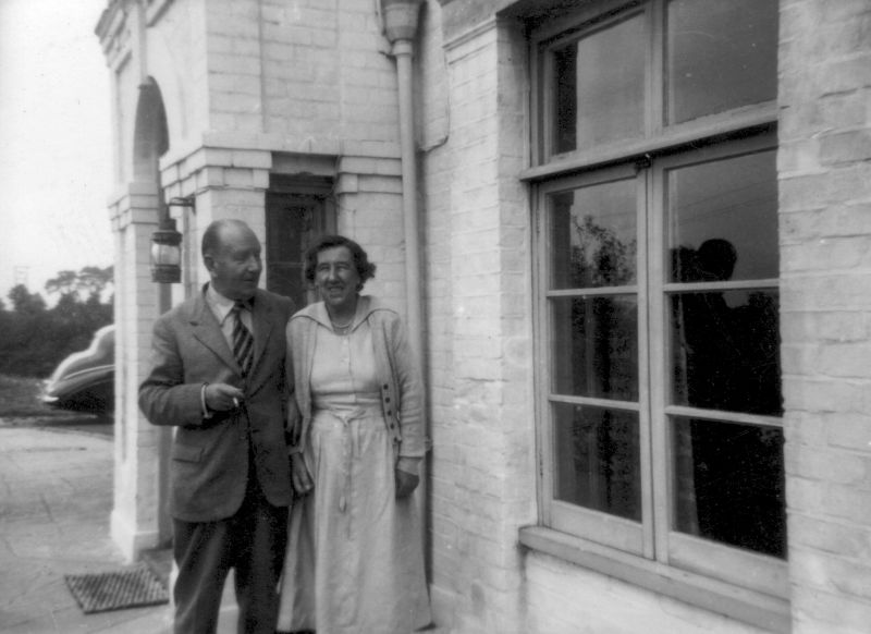 Gwendoline and Edward Harding outside their home - Strood Close, The Strood, Peldon. They named the house Strood Close. They had bought the house from cartoonist Leslie Grimes 1948/49. When they sold it in 1969, it was to the Church of England, and the house became The Vicarage, Peldon 2 or 3 years. The Tate family later named the house Pyefleet House. 