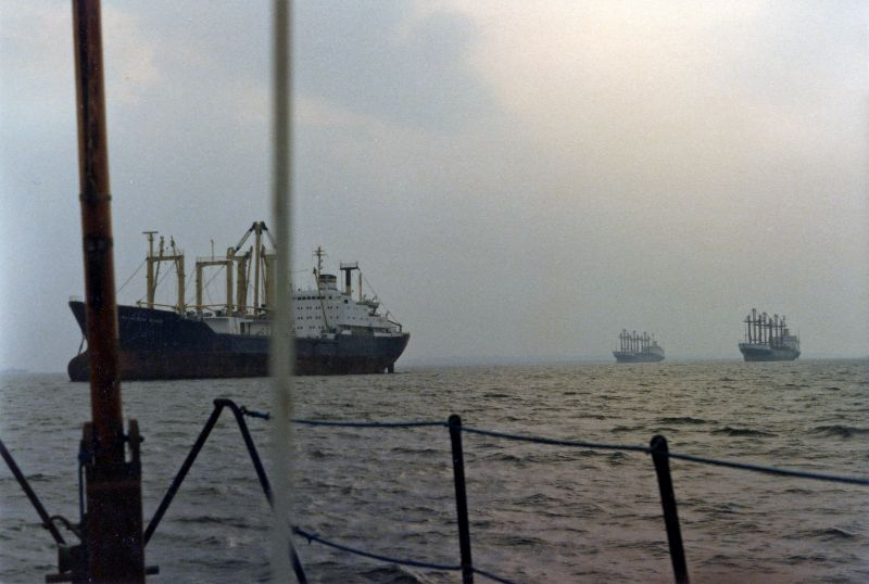 Ships laid up in the River Blackwater. ALIAKMON RIVER on the left, with SAPELE and SOKOTO in the distance. SOKOTO was in the river 1 August 1984 to 15 September 1984, helping date the photograph. Date: cSeptember 1984.