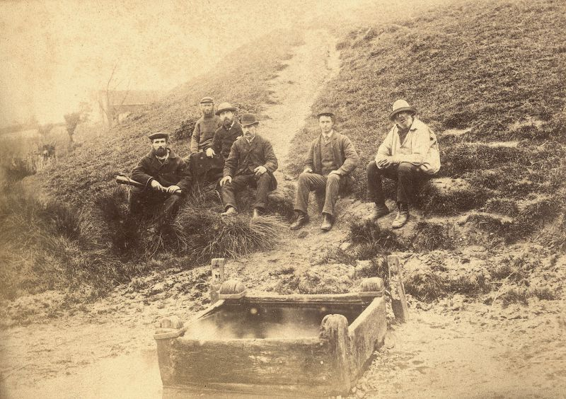 St Peter's Well, West Mersea, after earthquake on 14 April 1884. The crack caused by the earthquake can be seen in the path behind the men. A report says that by this time the crack had virtually closed up again. 