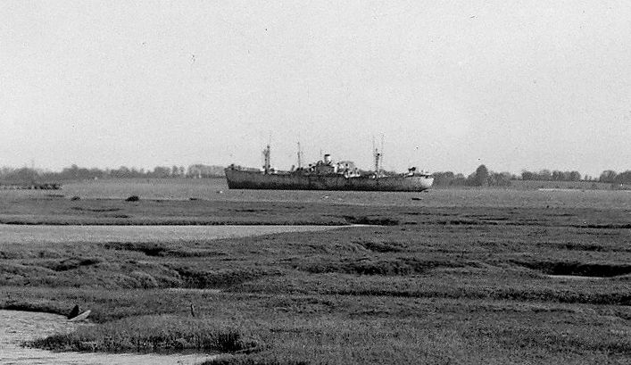The Liberty Ship SAMLONG in the River Blackwater, taken from Mell Creek, Tollesbury. Part of a postcard - see  ... Date: c1948.