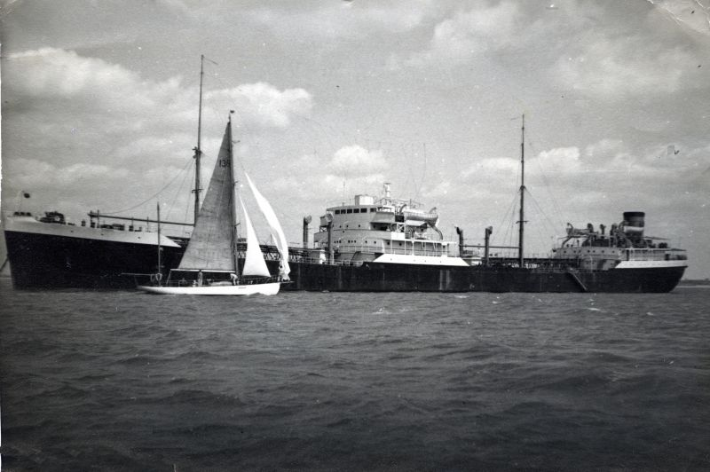 NEWCOMBIA laid up in River Blackwater. Yawl THALASSA in foreground. Date: c1959.