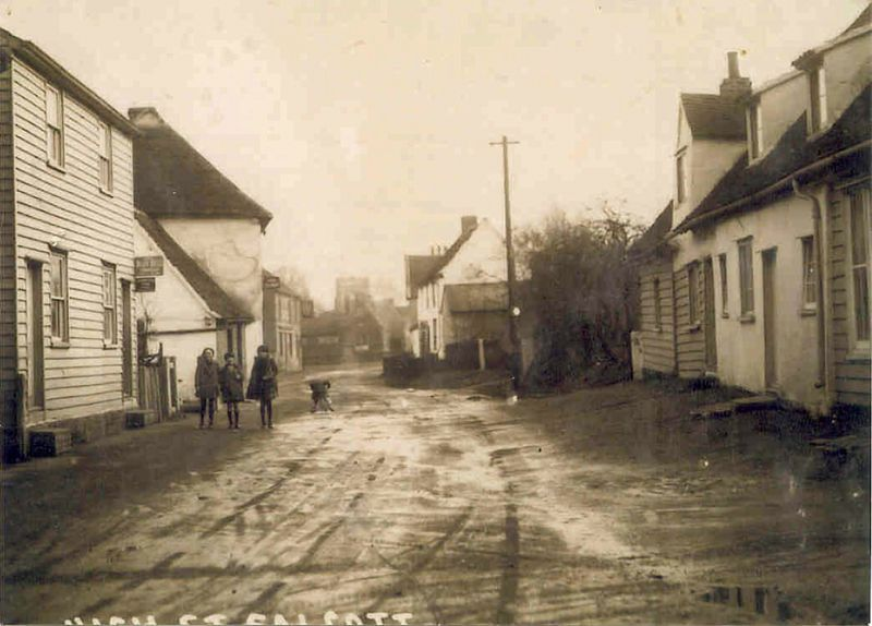 Salcott - the street. Ponder's butcher's shop on the right. The Sun Inn on the left in the distance. 1920s ? 