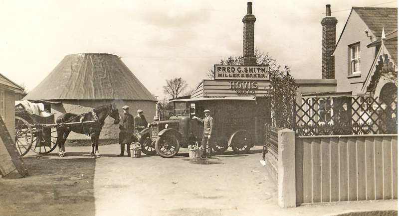 West Mersea Mill - Fred G. Smith. A wonderful photograph of the old and the new. Stanley Mole on the left holding the horse and Herbert Marrow far right with his hand resting on the van door. The Roundhouse remains after the windmill was removed. [AS] 