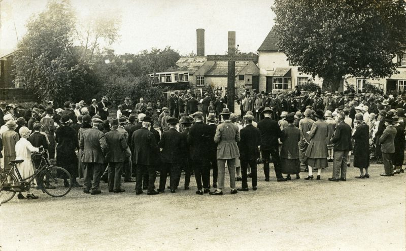 The War Memorial at Layer Cross, Layer de la Haye. It is a large gathering with a band in the background, and is thought to be for the dedication of the War Memorial in the 1920s.