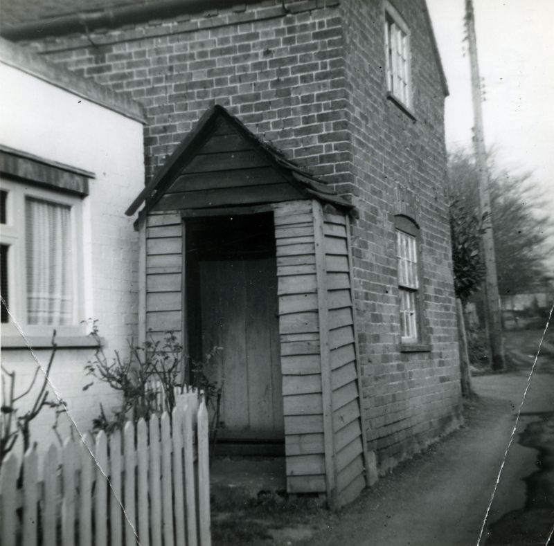 Grandmother Southgate's cottage onthe left. Mrs Cundy's cottage first door. The Lane. March 1961, just before Cundy's cottage was demolished.