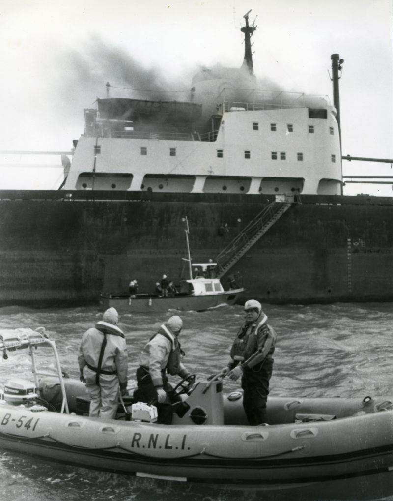 West Mersea lifeboat attending the cargo ship PROTOKLITOS on fire in the River Blackwater. The lifeboat is B-541 ELIZABETH BESTWICK on relief duty at Mersea. Date: 7 February 1983.