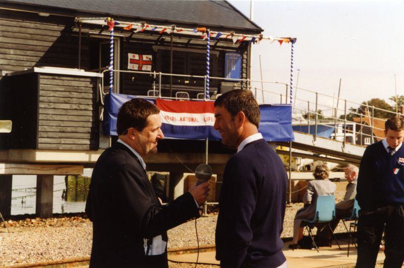 The Duke of Kent opening the new West Mersea Lifeboat house. Press man interviewing Peter Clarke. 