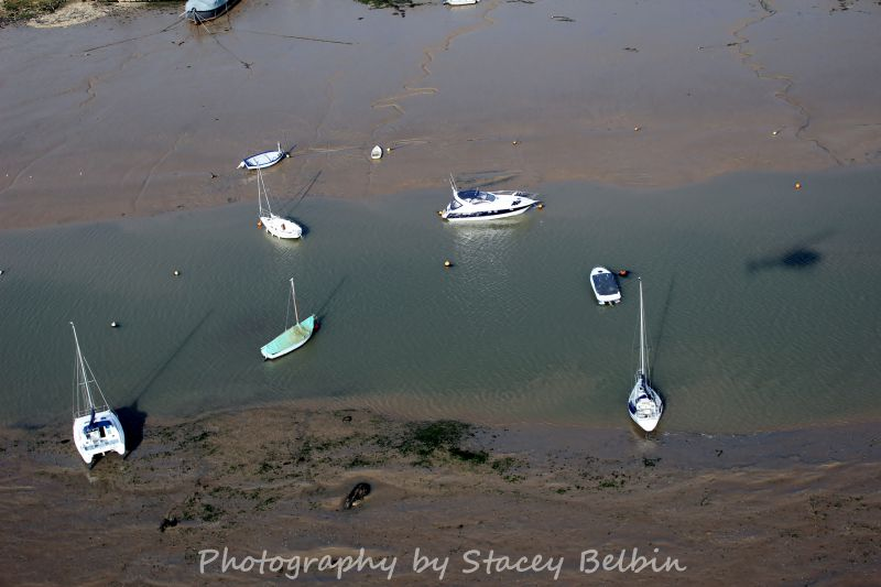 Boats at West Mersea. Bow of DAWN just visible at top. Shadow of Stacey's helicopter centre right.