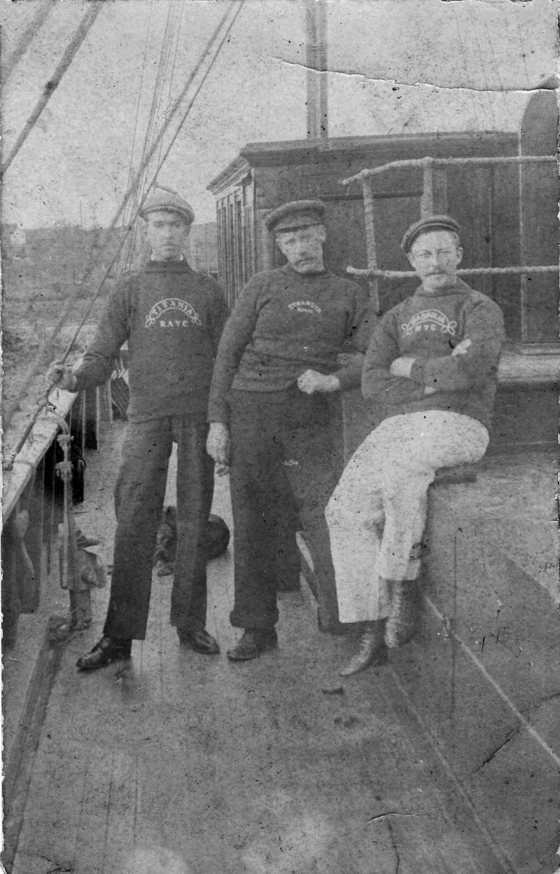George and William Sheldrick are in this photo but not sure who's who. The name on left jumper is TITANIA RAYC. Postmark is Wivenhoe, April 12, 1907 