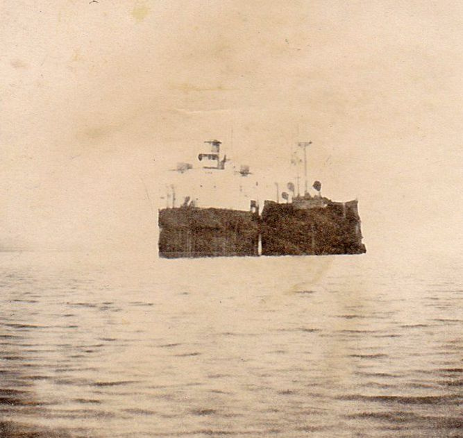 The two halves of the Liberty Ship HELENA MODJESKA anchored in the River Blackwater. She had gone aground on the Goodwin Sands 12 September 1946 and broke in two. The two halves were refloated and towed to the Blackwater January and June 1947. Date: Before 25 June 1948.