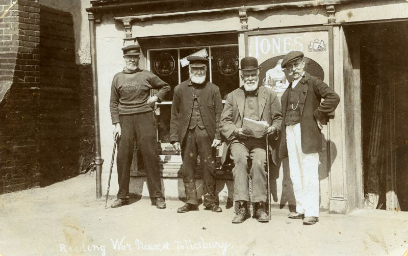 Reading War news at Tollesbury. Postcard.