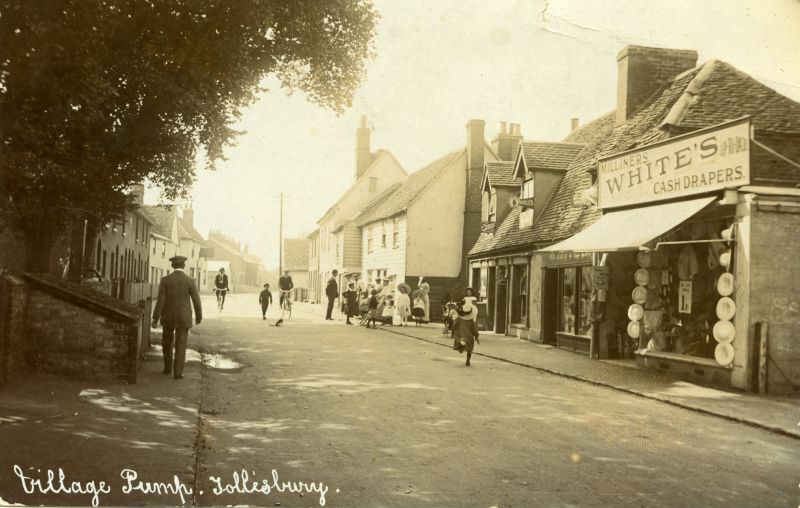Village Pump, Tollesbury. Opposite is White's Milliners and Cash Drapers. Hammond postcard. 