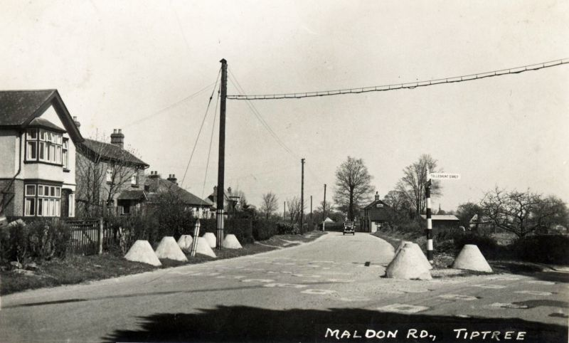 Maldon Road, Tiptree. Junction with Station Road. WW2 Anti-invasion barriers beside the road. 