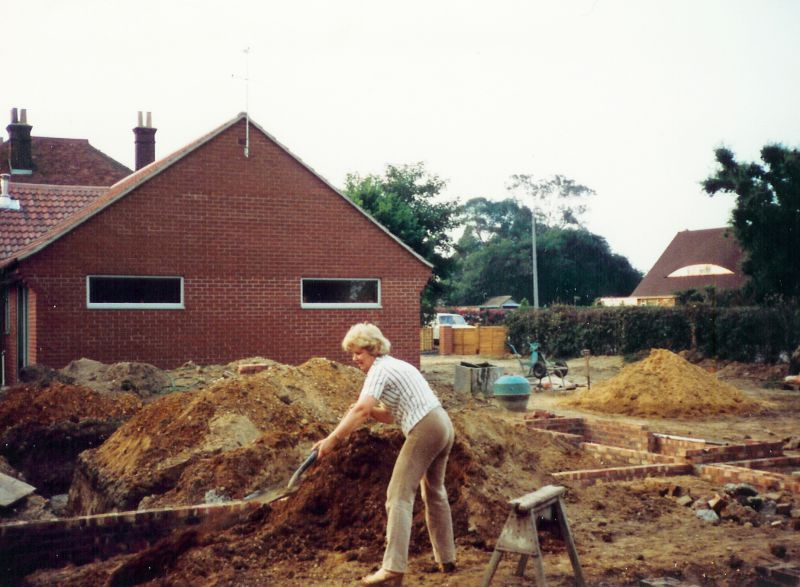 Builder Wendy Green at work in Seaview Avenue, building No. 52. 