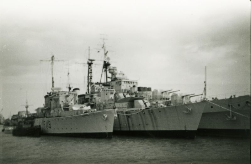 Royal Navy Ships, thought to be at Harwich. L-R Frigate F118 [ HMS TALYBONT, completed 1943, scrapped 1961 ], unidentified destroyer, unidentified cruiser.