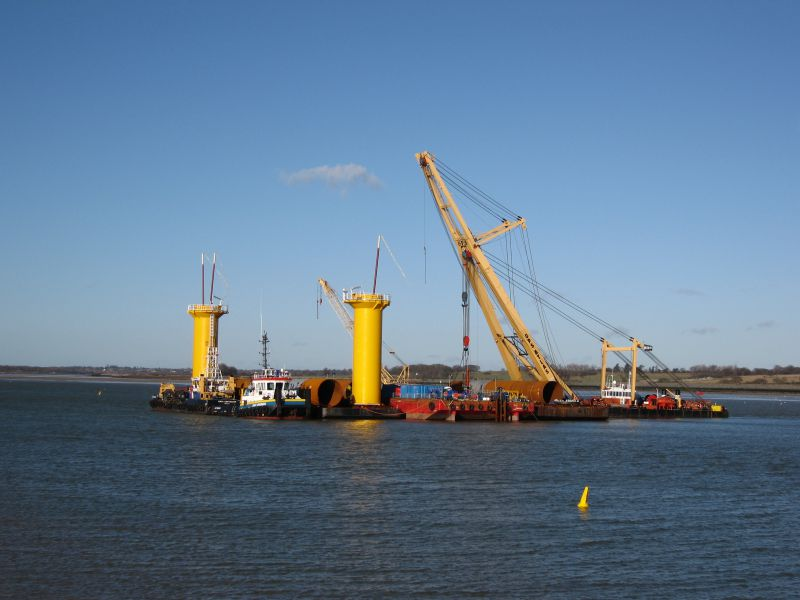 Vessels working on the Gunfleet Wind Farm construction, moored off East Mersea Stone to shelter from bad weather. FORTH CONSTRUCTOR, tug SMIT BRONCO, crane GPS ATLAS. 