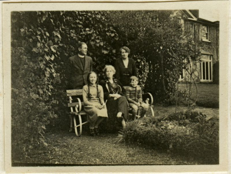 Reverend Frederick Yates and family in the grounds at Great Wigborough Rectory. Small photograph in home-made album. 