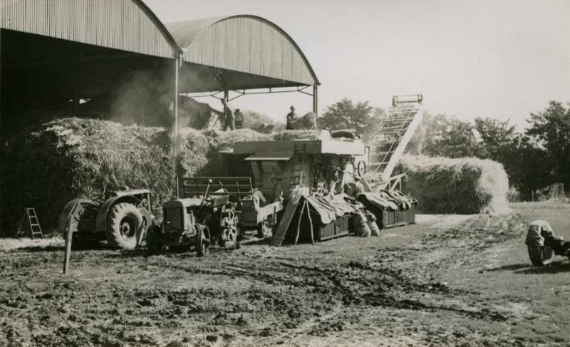 Thrashing at Wellhouse Farm in the Summer of 1944, when it was owned by Rosamund and Orson Wright. The tractor on the left is an early Marshall. 