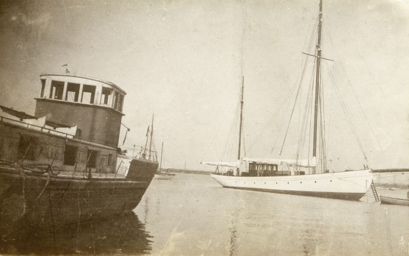 West Mersea Hard. The barge on the left was on the Hard for several years in the 1930s and probably survived the War. John Milgate tells us the deck eventually collapsed in on Regatta Day. Large ketch on the right.