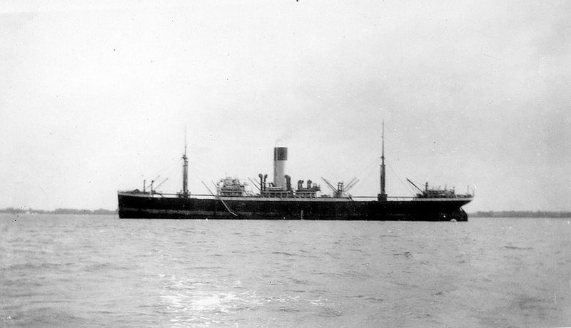 Blue Funnel Line vessel in the River Blackwater. Unidentified but one of the one of the Holts Standard Type built 1911-13. The vessels that surved WW1 were THESEUS, NELEUS, ATREUS, RHESUS, DEMODOCUS and LAOMEDON but most likely to be THESEUS which was laid up in in the river in the 1930s. Date: c1935.