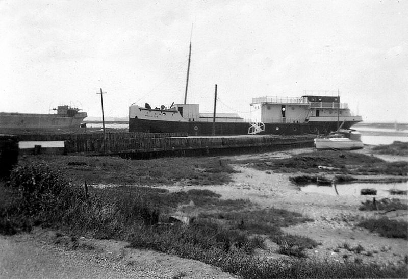 There are two concrete boats in this picture. On the left is CRETACRE, built Hamworthy in 1918 and owned in Mersea 1933-38. In the centre is MOLLIETTE - a well known local houseboat, built of concrete in Faversham in 1919. She lay in front of the VICTORY for many years, used as West Mersea Yacht Club clubhouse. Her remains lie off East Mersea, sunk as a target in World War 2. 