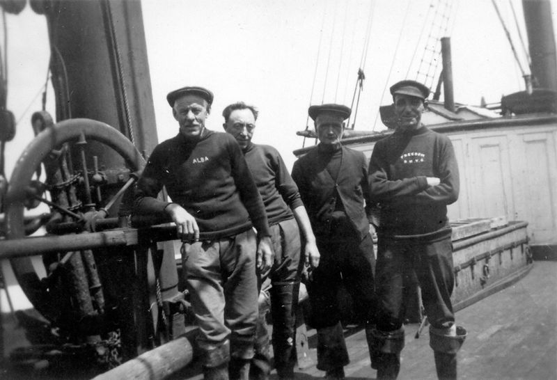 Old Bob South, Ed Wyatt, ?, ? on board the barque ALASTOR - laid up in the River Blackwater. Date uncertain. Date: 1935.