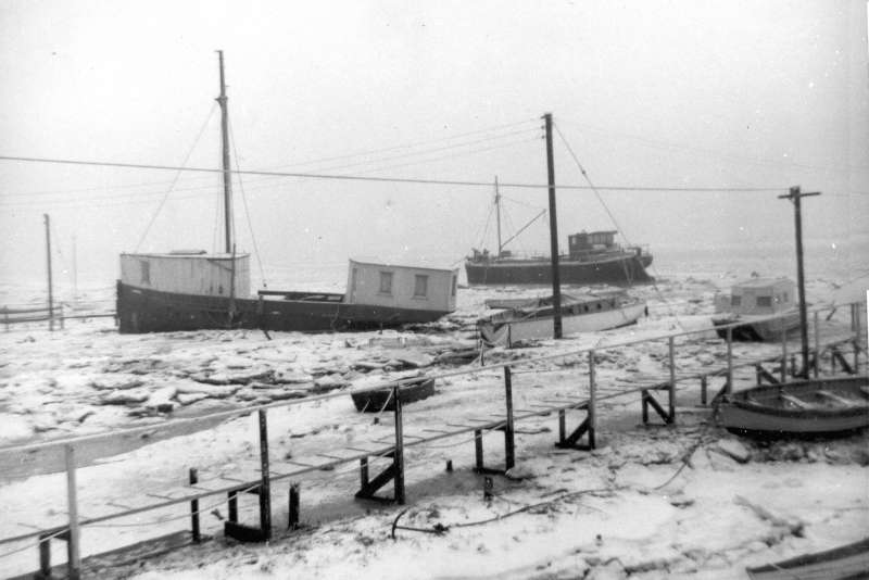 Ice around the houseboats in the hard winter 1962 - 1963. MEG MERRILIES and beyond her FATHOM ex DOROTHY, a former Admiralty ammunition barge. 