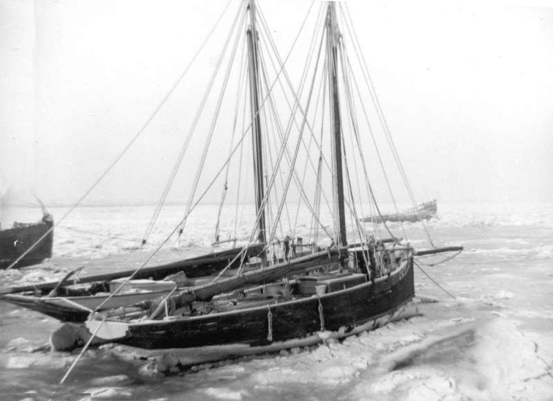 1963 Winter, smacks IRIS and MAUD in the ice. The hulk of the PIONEER lies in the distance.