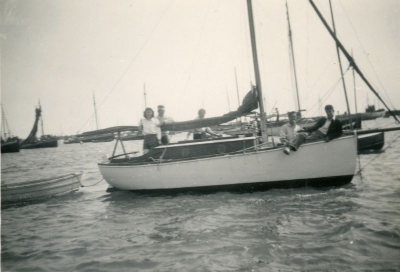 Unknown yacht. The boat astern of her looks like one of the boats built for Mersea Boating Lake before the War. Photo at Brightlingsea ? 