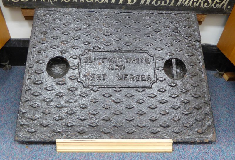 Clifford White & Co West Mersea. Manhole cover. On display in Mersea Museum, Benham Wing 