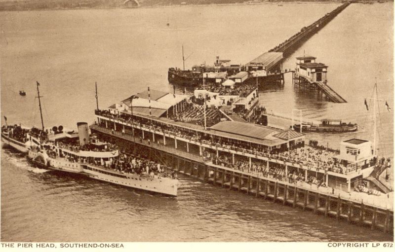 Southend pier, paddlesteamer alongside. 