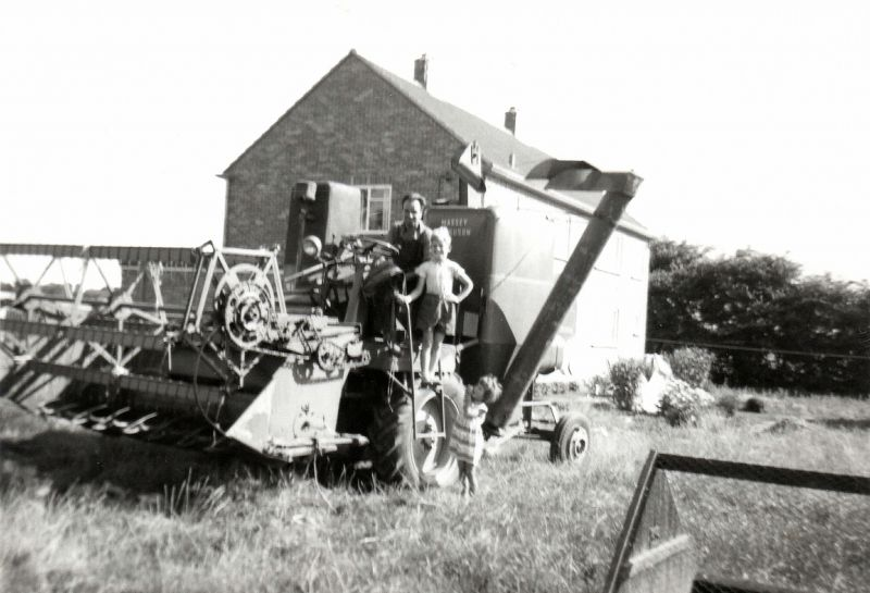 Bernie Ratcliffe and children on a Massey Ferguson 780 combine at Rivenhall. They lived there for a while, before returning to Wigborough. 