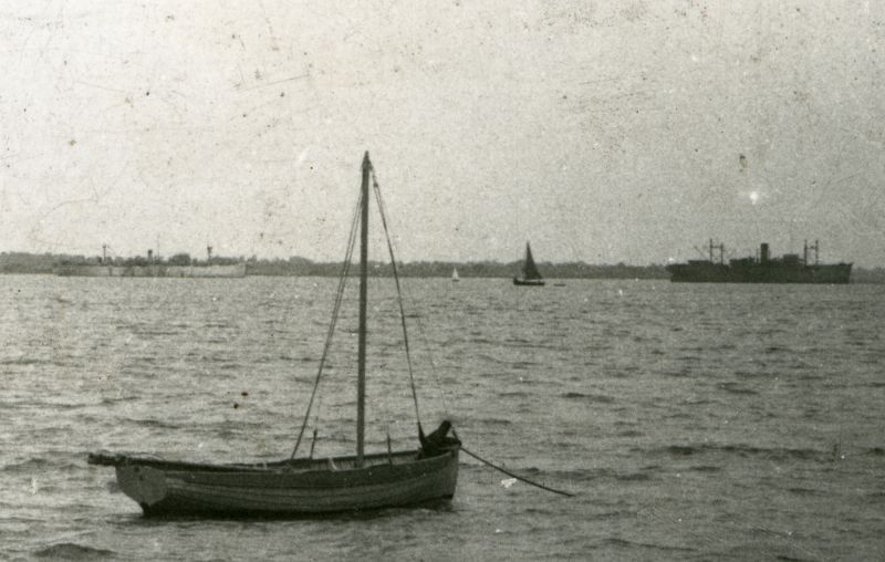 Part of a postcard of West Mersea beach. PHILOCTETES is on the right. Date: c1947.