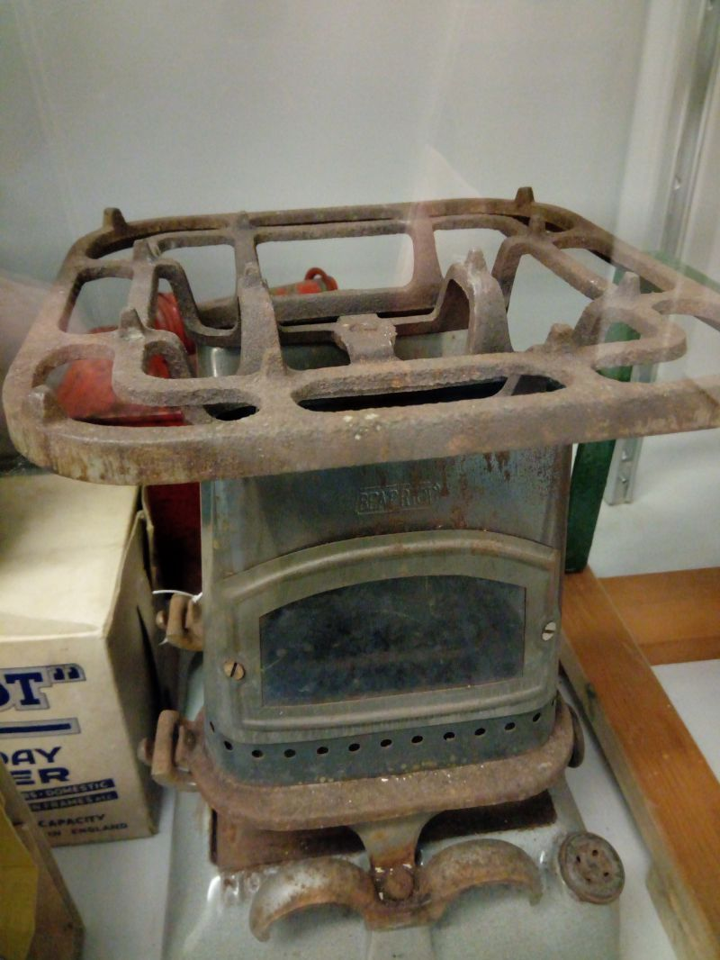 Small two burner paraffin stove used by donor's grandmother, Edith Hyam, from Peldon. On display in Mersea Museum.